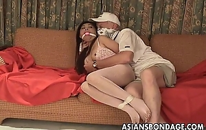 Oriental slut is getting roped up and treated to a bdsm session